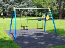 Swings playground city park Stock Image