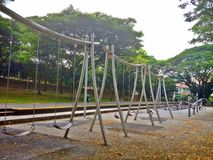Swings in playground Royalty Free Stock Photography