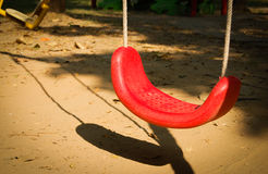 Swings in the playground Stock Photo