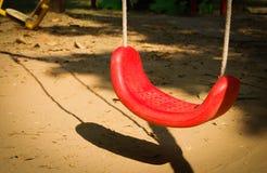 Swings in the playground. Garden kids Stock Photo