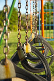 Swings on a playground Stock Photos