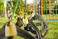 Swings on a playground Stock Image