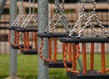 Swings at a public playground Royalty Free Stock Photos