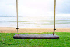 Swings by the sea. Stock Image