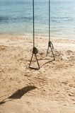 Swings on the tropical beach. Stock Photo