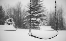Swings in winter Royalty Free Stock Photo
