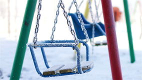 Swings in winter park Stock Photography
