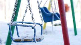 Swings in winter park stock footage