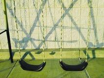 Swingset en het is schaduw Stock Afbeelding