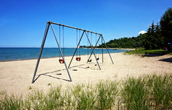 Swingset by the Lake Royalty Free Stock Image