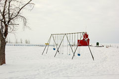 Swingset with light house in the background Stock Photo