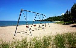 Swingset pelo lago Imagem de Stock Royalty Free