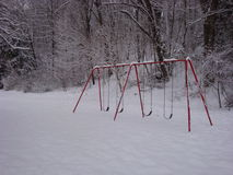 Swingset in the snow Stock Images