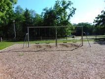 Swingset. Swing set at a playground royalty free stock image