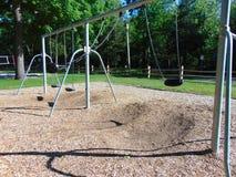 Swingset. Swing set at a playground stock photo