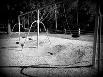 Swingset. Swing set at a playground royalty free stock photo