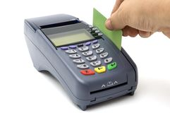 Swiping credit card with POS-terminal Royalty Free Stock Photos