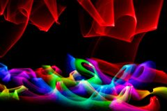 Swirl of colored lights against black background royalty free stock photography
