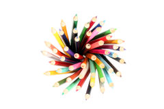 Swirl of Colours. Crayons standing upright and swirled around to form a head Royalty Free Stock Photography