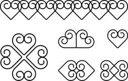 Swirl heart symbols Stock Images