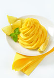 Swirl of lemon cream Stock Images