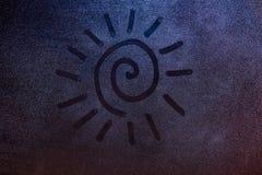 Swirl shape sun draw. On foggy window background. Concept drawing on frozen window night light Royalty Free Stock Photography