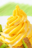 Swirl of yellow cream with kiwi Stock Image