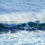 Swirled blue colored ocean wave Stock Photo
