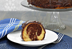 Swirled chocolate and vanilla cake with chocolate frosting. Royalty Free Stock Photography