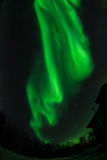 Swirling aurora over house royalty free stock images