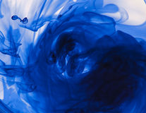 Swirling blue ink Stock Photography