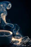 Swirling golden smoke taking away from coffee Stock Photo