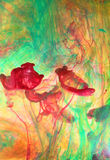 Swirling ink in liquid. Vibrant colorful inks swirling in liquid stock photo