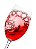 Swirling red wine. Red wine swirling round in a wine glass isolated on white Royalty Free Stock Photo