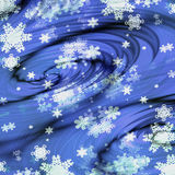 Swirling snowflakes on a blue background. Spirals with snowflakes creating an illusion of movement Royalty Free Stock Photography