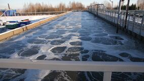 Swirling waste water in huge reservoir at aerating process