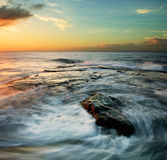 Swirling waves at sunset. Taken at the Tip of Borneo, Borneo, Sabah, Malaysia Royalty Free Stock Image
