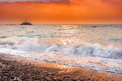 Swirling waves at sunset in Greece stock photography