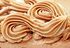 Swirls. Close up of decorative chocolate frosting on cake royalty free stock images