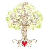Swirly dekorativt träd med en röd hjärta Arkivfoto
