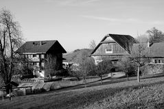 Swis chalets. Black and white photo of Swiss chalets in the countryside of Switzerland Stock Photography