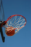 Swish... Nothing But Net!. Basketball scores a goal hitting nothing but the bottom of the net Royalty Free Stock Photo