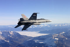 Swiss Air Force F A-18C Hornet flies over the Alps. Stock Photography