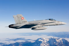 Swiss Air Force F A-18C Hornet flies over the Alps. Royalty Free Stock Images
