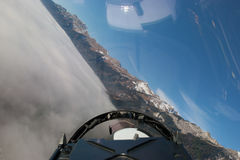 Swiss Air Force F A-18C Hornet flies over the Alps. Stock Photo