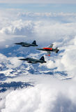 Swiss Air Force F-5E Tiger IIs in formation over the Alps. Stock Photography