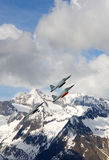 Swiss Air Force F-5E Tiger IIs in formation over the Alps. Royalty Free Stock Photo