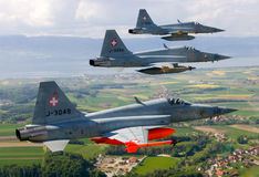 Swiss Air Force F-5E Tiger IIs in formation over the Alps. Royalty Free Stock Images