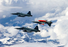 Swiss Air Force F-5E Tiger IIs in formation over the Alps. Royalty Free Stock Photography