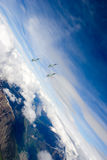 Swiss Air Force F-5E Tiger IIs in formation over the Alps. Royalty Free Stock Photos